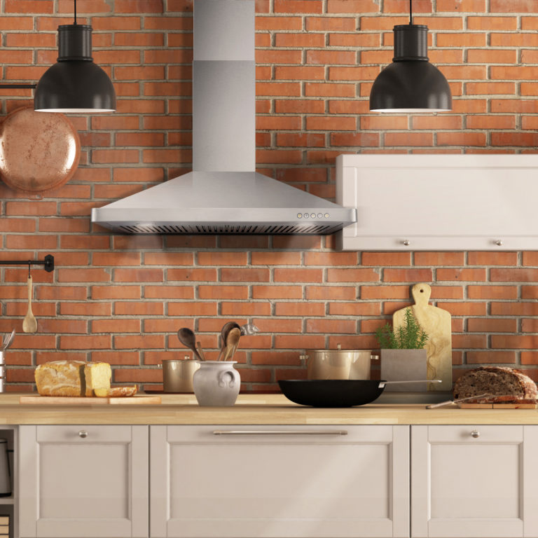 Retro white kitchen in a old interior with brick wall